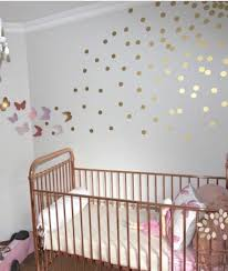 Wall Decals For Baby Nursery Baby Nursery With Copper Metal Crib And Gold Wall Decals Baby