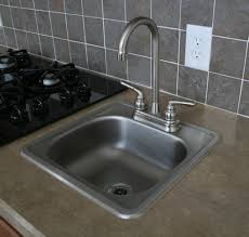 brushed nickel kitchen faucet with stainless steel sink