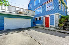 clapboard siding house in blue color with red trim house with
