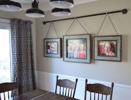 wall ideas for living room this family came up with a unique way to hang their photo display