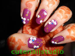 cute nails flower petals made of acrylic and gold glitter nail art
