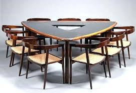 triangle dining room table triangle shaped table by1 co
