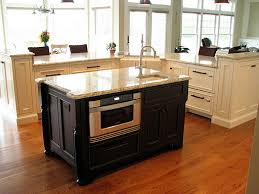 white kitchen with black island kitchen island design cape island kitchens