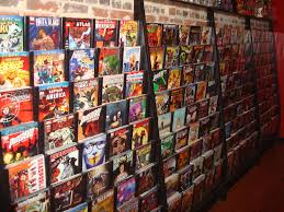 comic display with a shelf up top to display collectables store