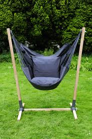 noa hanging chair stand made of hardwood brazilian teak with