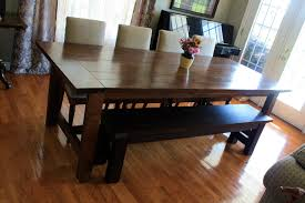 kitchen dark briwn solid wooden rectangle dining table with bench