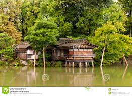 traditional japanese house on the water columns stock photo