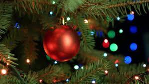garlands and snowflake lights on a christmas tree holiday stock