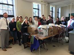 rotary club joins middle school tradition of packing thanksgiving