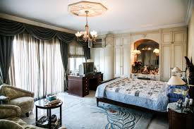 the luxurious mansion with 5 bedrooms and a master suite there