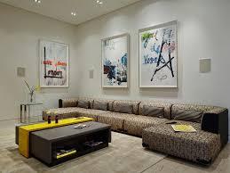 Dining Room Framed Art Yellow Walls Curved Sofa Wood Mantel Light Maple Floors Modern
