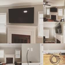 curved oled tv mounted over fireplace sound bar mounted floating