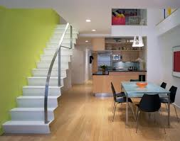 contemporary stairs design with green wall paint and recessed