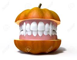 halloween teeth a humorous halloween concept of a pumpkin split in two with