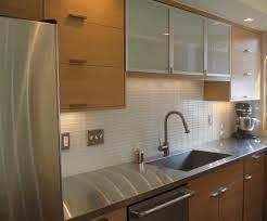 stainless subway tile backsplash steel stove hood bronze brown