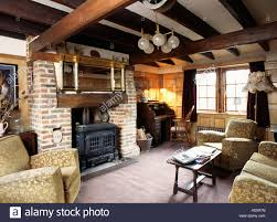 country livingrooms traditional conversion stock photos country black stove in brick fireplace in traditional livingroom with beamed ceiling stock image