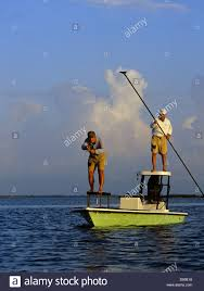 fishing guides port aransas a fly fisherman and his guide casting for redfish from their