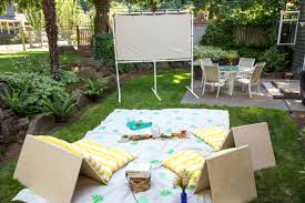 make your own screen for an outdoor movie night home improvement