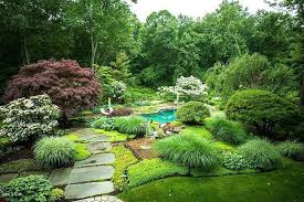 traditional landscape and yard with pathway pond in greenwich