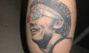 i have a tattoo of bruce springsteen wearing 3d glasses on my leg