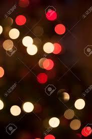 red white christmas lights christmas tree defocused red and white christmas lights creating