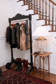 accordian coat rack with wood staircase entry traditional and