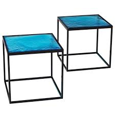 multiple blue coloured glass side tables with metal