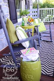 front porch sitting creating a stylish outdoor space stonegable i also added a small table painted bright lime green isn t this the most fun color valspar crushed oregano