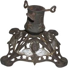 germany antique cast iron christmas tree stand with cherub faces