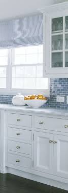white kitchen cabinets with blue tiles painted cabinetry kitchen paint color bathroom colors and