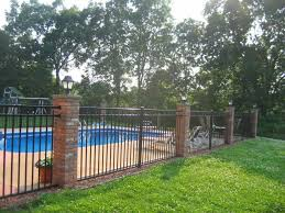 vertical wooden backyard fence ideas with pointed top caps over