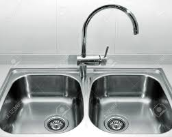 Double Bowl Stainless Steel Kitchen Sink A Double Bowl Stainless Steel Kitchen Sink On A White Granite