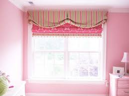 girls silk drapes and balloon valance with roman shade in nursery