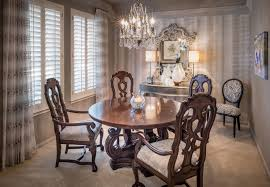 decor transitional dining room using upholstered white chairs and
