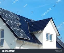 solar panel on dark roof stock photo 437916526 shutterstock