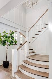 stained oak curved stair treads cottage entrance foyer