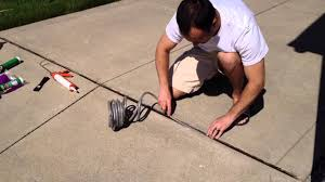 Cover Cracked Concrete Patio by Diy Repair Driveway Expansion Joints Youtube