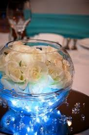 centerpiece bowls for tables table centrepiece soljans fish bowl cream roses silver wire with