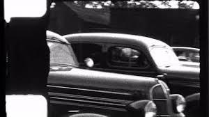 woman drives old car auto antique backs up 1940s vintage film home