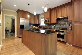 traditional medium wood golden kitchen cabinets 61 kitchen