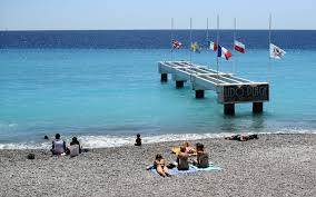 Why Are The Flags Flying Half Mast Burkini Ban On Nice Beaches Sparks Outrage Travel Leisure