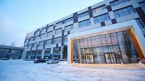 facade with big glass entrance of business center at winter snowy