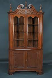 Corner Cabinet Shelves by Furniture Carved Brown Polished Wooden Corner Cabinets With Doors