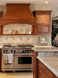 vintage wooden kitchen hood and cabinets over brown granite