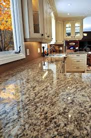 granite countertop oak kitchen wall cabinets backsplash pattern