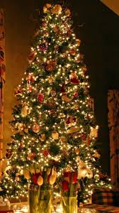 download wallpaper 750x1334 christmas tree ornaments fireplace