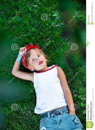 white shirt white necklace images Cool little girl outdoor lying on the grass child in white t jpg