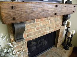 wrought iron corbels look incredible beneath fireplace mantels because they match other nearby metal elements such as fireplace tool sets