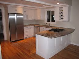 Kitchen Peninsula With Seating by Kitchens Machnee Custom Woodworking