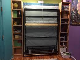 sliding bookcase murphy bed best 25 murphy door ideas on pinterest bookcase picture bookcases